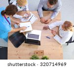 male and female doctors working ... | Shutterstock . vector #320714969