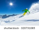 skier skiing downhill in high... | Shutterstock . vector #320731085