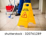 Low Section Of Worker Mopping...