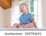 beautiful baby boy laughing | Shutterstock . vector #320792651