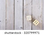 Two Dices On Wood Table