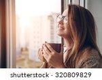 cheerful girl drinking coffee... | Shutterstock . vector #320809829