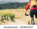 mountain biker riding on bike... | Shutterstock . vector #320842457