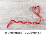 red heart ribbon on grey... | Shutterstock . vector #320898464