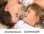 portrait of a happy mother and... | Shutterstock . vector #320944289
