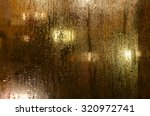 night lights behind wet glass | Shutterstock . vector #320972741