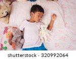 a little asian boy sleep with... | Shutterstock . vector #320992064