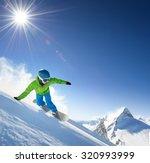 snowboarder skiing in high... | Shutterstock . vector #320993999
