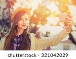 beautiful teenage girl in beige ... | Shutterstock . vector #321042029