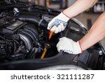 mechanic changing oil | Shutterstock . vector #321111287