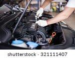 hands of car mechanic in auto... | Shutterstock . vector #321111407