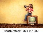Kid shouting through vintage megaphone. Communication concept. Retro TV - stock photo