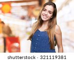 young woman smiling over white... | Shutterstock . vector #321119381