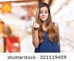 young woman doing a rich gesture | Shutterstock . vector #321119459