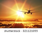plane is taking off at sunset | Shutterstock . vector #321121055