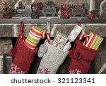 Stuffed stockings hanging on a...