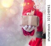 santa claus gloved hands... | Shutterstock . vector #321148961
