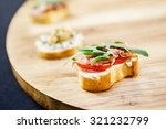 tasty canape | Shutterstock . vector #321232799