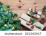 christmas presents under a tree | Shutterstock . vector #321242417