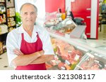 butcher proud of his shop | Shutterstock . vector #321308117
