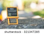 child blackboard stands on the... | Shutterstock . vector #321347285