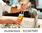 Pouring Fresh Beer. Close Up O...