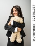 Young Woman Hugging A Teddy Bear