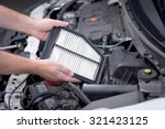 Small photo of Replacing an air filter in a car