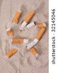 Cigarettes In Sand