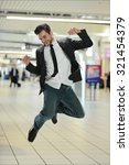 Young Businessman Jumping Of...