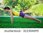 beautiful sporty woman doing...   Shutterstock . vector #321504095