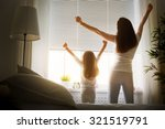 mother and daughter enjoying... | Shutterstock . vector #321519791