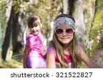 little girl on bike in autumn... | Shutterstock . vector #321522827