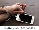 male hands and smartphone.... | Shutterstock . vector #321563435