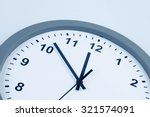 closeup of hands on clock face | Shutterstock . vector #321574091