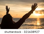 image of a woman raising hands... | Shutterstock . vector #321638927