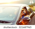 smiling woman driving a car at... | Shutterstock . vector #321687965