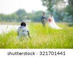 wedding photographer taking... | Shutterstock . vector #321701441