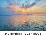 sunset on the lake | Shutterstock . vector #321748031