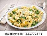 tagliatelle with cream and peas | Shutterstock . vector #321772541