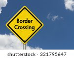 Border Crossing Road Sign, Yellow Caution sign with word Border Crossing with sky background