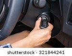 women driver hand inserting car ... | Shutterstock . vector #321844241