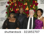 Small photo of New York, NY - September 28, 2015: LaTanya Richardson, Samuel Jackson, George Lucas, Melody Hobson attend American Theatre Wing 2015 gala at Plaza Hotel
