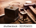 gold nuggets on a old anvil ... | Shutterstock . vector #321926321