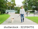 Stock photo family pet animal and people concept happy man with labrador retriever dog walking in city park 321934751