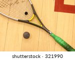 squash raquet on the floor with ball - stock photo