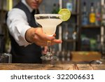 barman serving margarita... | Shutterstock . vector #322006631