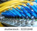 network hub and patch cables,Fiber cables connected to servers in a datacenter(See more network cables and servers backgrounds in my portfolio). - stock photo
