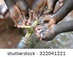 hands of african children... | Shutterstock . vector #322041221