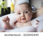 baby bath time | Shutterstock . vector #322042445